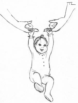 Un bébé avec son réflexe d'agrippement